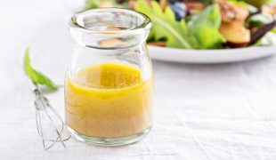 Salad dressing with olive oil, honey, mustard and vinegar